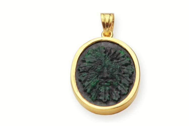 Jade pendant featuring the Green man
