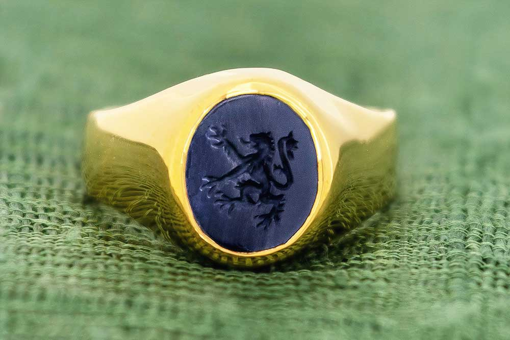 Gold lion signet ring
