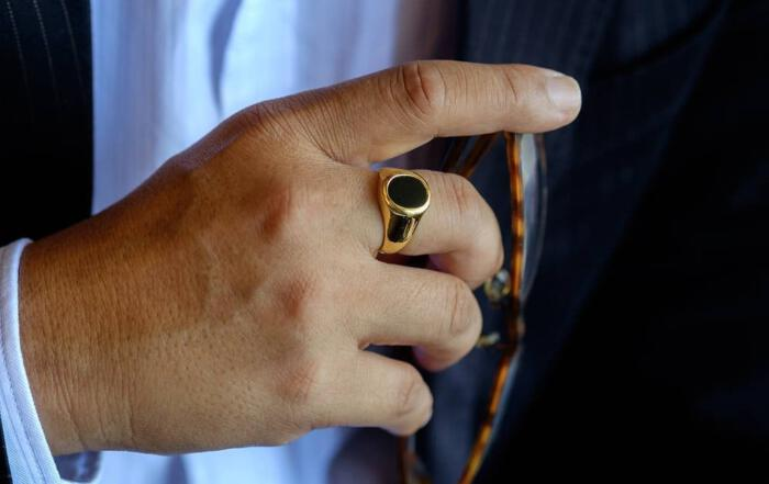 Black onyx rings in men's fashion